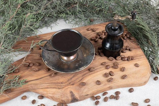 Coffee grinder, beans and aroma coffee on wooden board