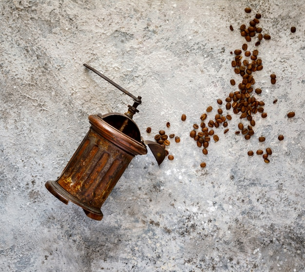 Coffee grinder hand vintage with roasted coffee beans