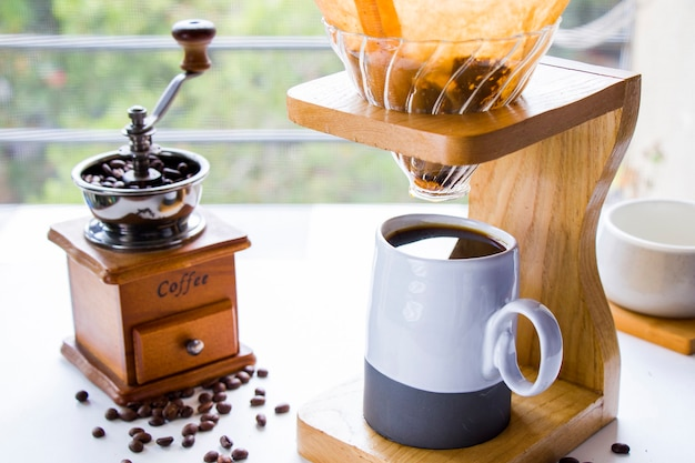 Coffee grinder, maker, cup and beans, morning coffee, energy drink