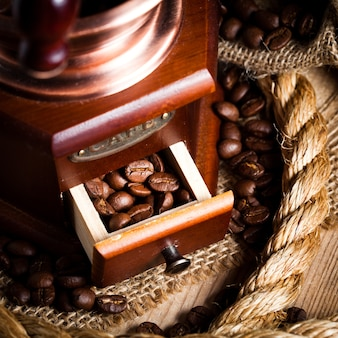 Coffee in grinder and rope still life