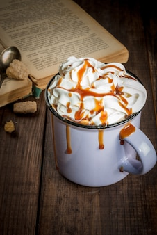 Coffee or hot chocolate and old book