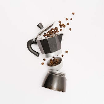 Coffee kettle with roasted beans