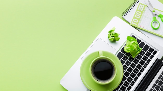 Coffee on laptop copy space