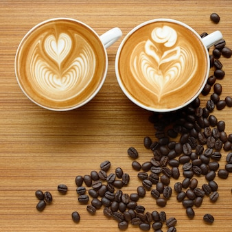 Coffee latte art and  mocha on old wooden background square frame image.