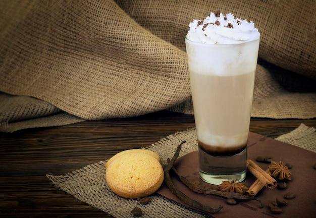 Coffee latte. coffee with whipped cream topping in  a tall glass