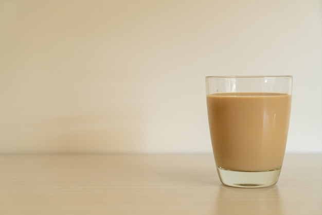 Coffee latte glass with ready to drink coffee bottles on the table