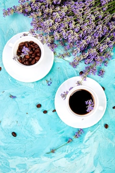 Coffee and lavender flower on blue background from above. Premium Photo
