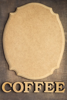 Coffee letters and signboard at old wooden background, top view