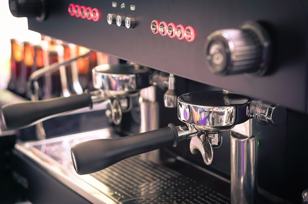Coffee machine in counter of cafe shop the morning, vintage style background