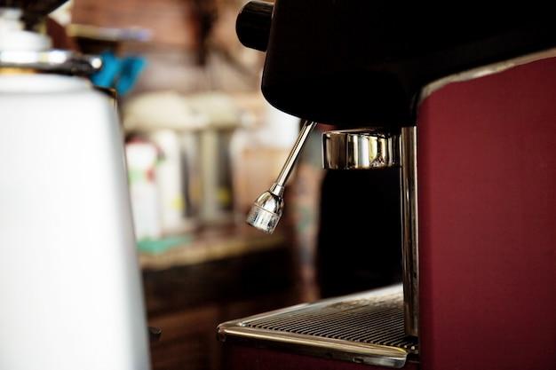 Coffee maker in shop.