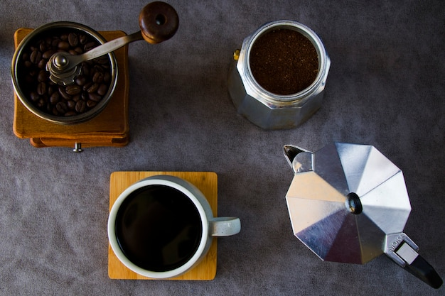 Coffee makers and beans, cup of coffee