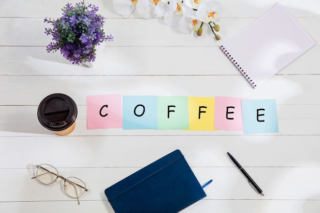Coffee message at colorful note papers on a desk