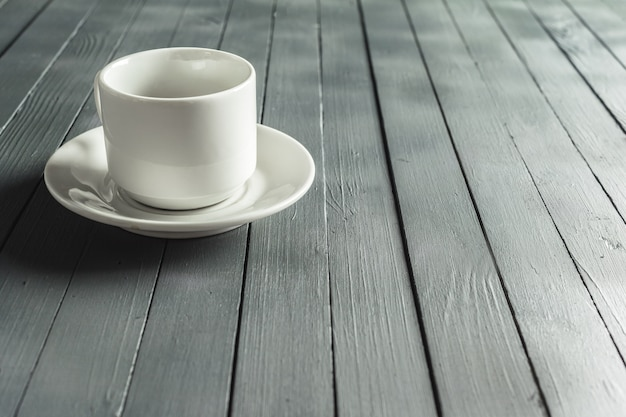Coffee mug on a dark wooden table