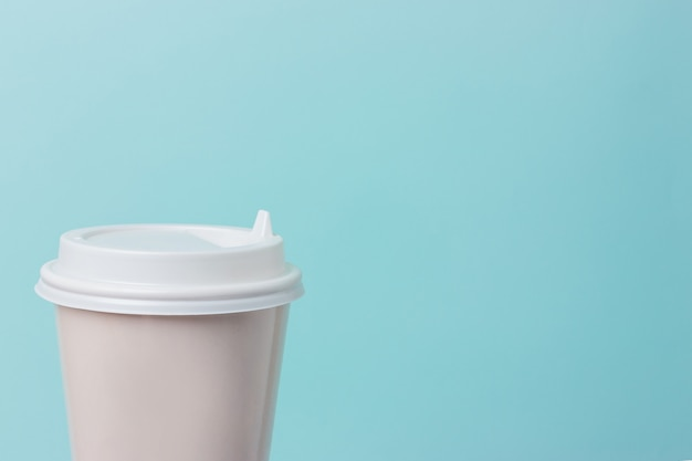 Coffee paper cup isolated on light blue background