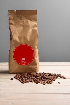 Coffee paper pack with scattered coffee beans on wooden table. copy space for text.