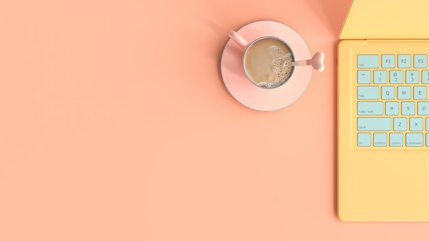 Coffee pink cup beside laptop yellow color on work desk top view and copy space