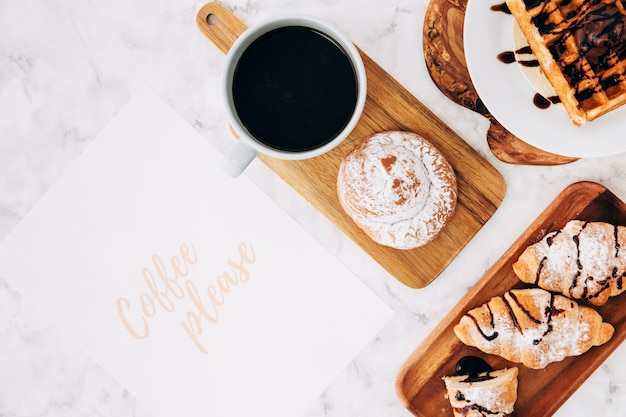 Coffee please text on paper with healthy breakfast and coffee cup over the marble background