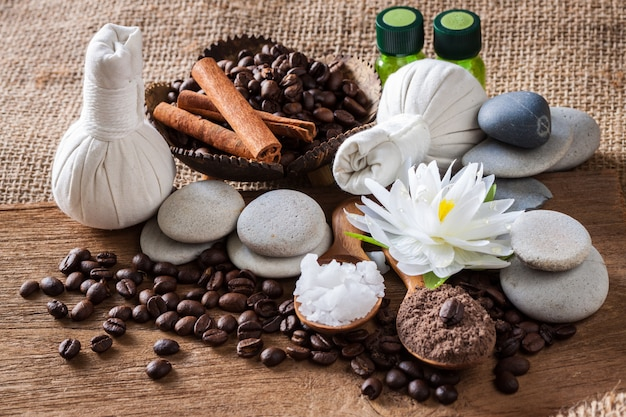 Coffee powder and salt scrub, spa and massage objects, wellness and relaxation concept
