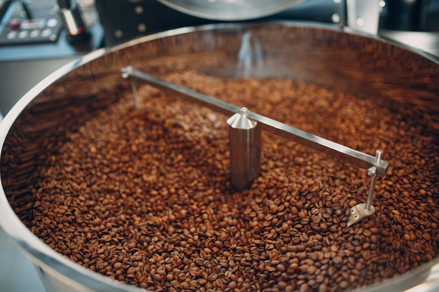 Coffee roaster machine at coffee roasting process. mixing coffee beans.