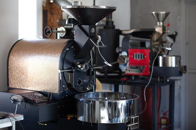 Coffee roaster machine at coffee roasting process.