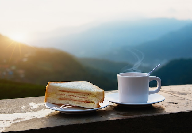 Coffee and sandwich in morning on mountain view.