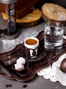 Coffee served with turkish delights and glass of water