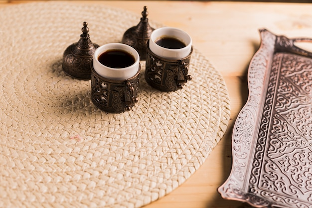 Coffee set from tray and two cups of coffee