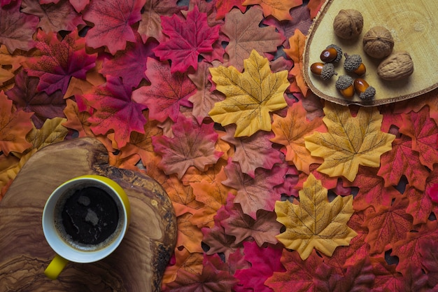 Coffee set with autumn leaves and nuts