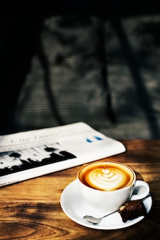 Coffee shop cafe latte cappuccino newspaper concept