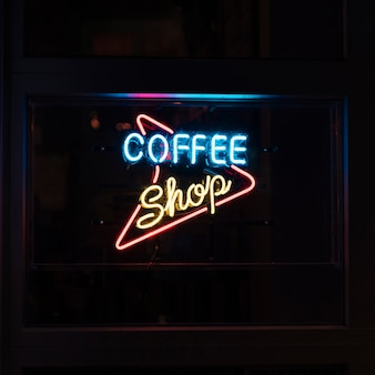Coffee shop sign in neon lights for nocturnal people