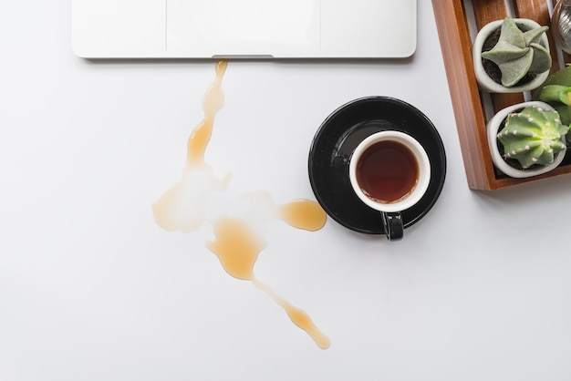 Coffee spilled over workspace