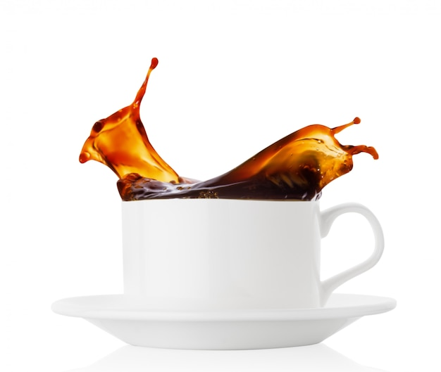 Coffee splash in a white cup with saucer
