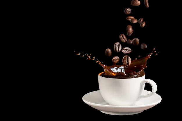 Coffee splashes with falling coffee beans on dark background