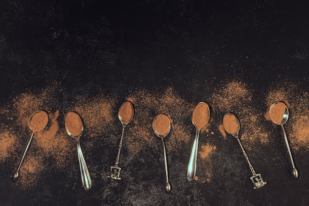 Coffee spoons on black background