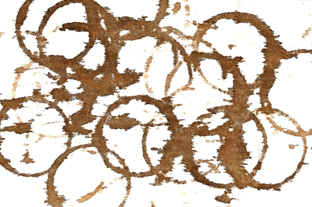 Coffee stains on textile table-cloth isolated on the white background