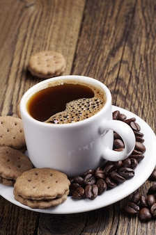 Coffee and sweet cookies on wooden table