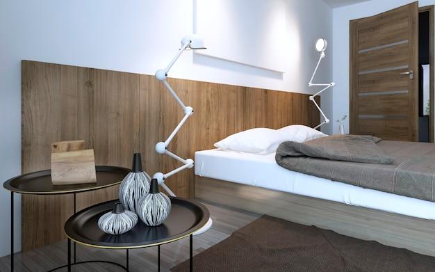 벽 장식 목재 패널이있는 미니멀 한 침실의 침대 근처 커피 테이블과 램프. 브라운 인테리어. 3d 렌더링