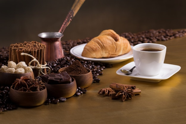 Coffee table with coffee beans and aromatic ingredients