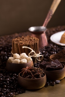 Coffee table with sugar cubes, chocolates and cinnamon