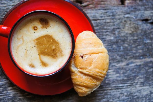 Coffee time, coffee cup on wood