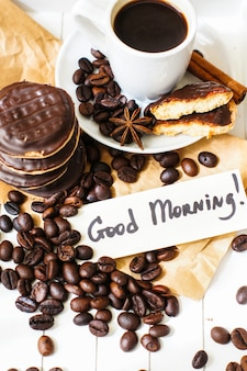 Coffee time with coffee cup and cookies