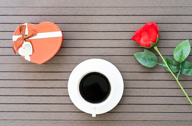 Coffee time with coffee cup, red rose