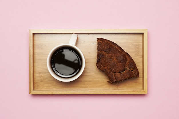 Coffee top view a piece of cake on wooden table. breakfast concept. gastronomy. flat lay flat design