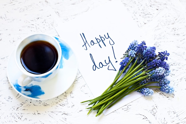 Coffee on white background and flowers. spring. morning. march 8. women's day