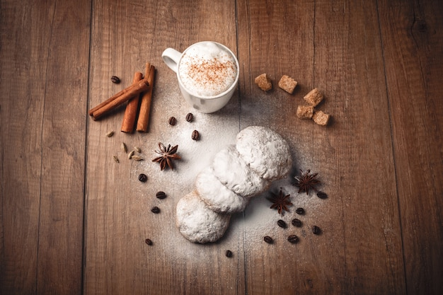 Coffee with biscuits and cinnamon