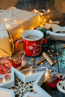 Coffee with cinnamon and milk in christmas atmosphere