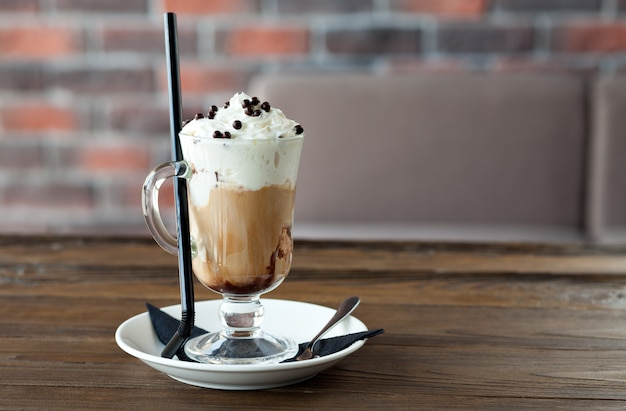 Coffee with cream and chocolate balls