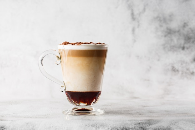 Coffee with irish whiskey and whipped cream in glass isolated on bright marble background. overhead view, copy space. advertising for cafe menu. coffee shop menu. horizontal photo.