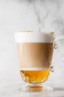 Coffee with irish whiskey and whipped cream in glass isolated on bright marble background. overhead view, copy space. advertising for cafe menu. coffee shop menu. vertical photo.