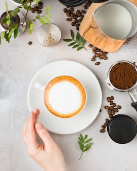 Coffee with latte art in a white ceramic cup on a table